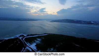 Aerial view of sea at dusk 4k