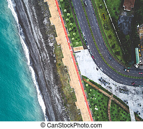 Aerial view of sea, beach and embankment with no people -...