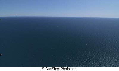 Aerial view of sea surface, shot from hang glider. Canon EOS...