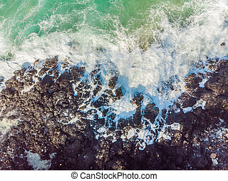 Aerial view of sea waves and fantastic Rocky coast
