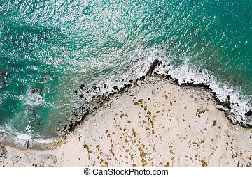 Aerial view of sea waves and rocky coast, Turkey.