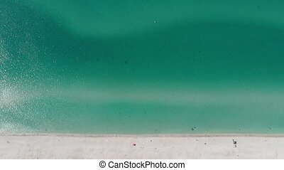 Aerial view of sea waves crashing on beach without people. drone footage.