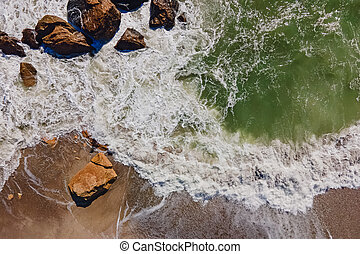 Aerial view of sea waves on the shore