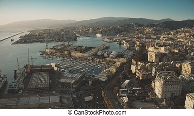 Aerial view of seaport and cityscape of Genoa in the...
