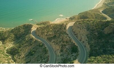 Aerial view of seaside windy car roads in Spanish mountains