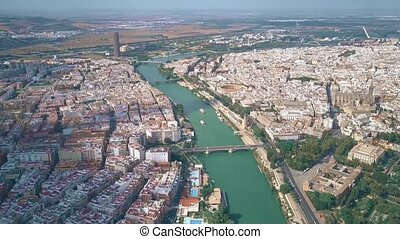 Aerial view of Seville cityscape and the Guadalquivir river, Spain