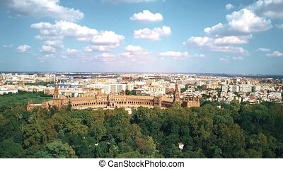 Aerial view of Seville, Spain involving famous Plaza de Espana and Maria Luisa Park
