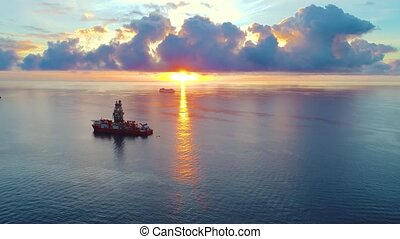 aerial view of ship at sunrise - aerial view of ship in...