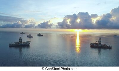 aerial view of ships at sunrise - aerial view of ships in...