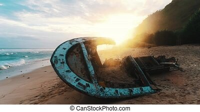 Aerial view of shipwreck at the beach during amazing sunset...