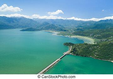 Aerial view of Skadar lake and dam