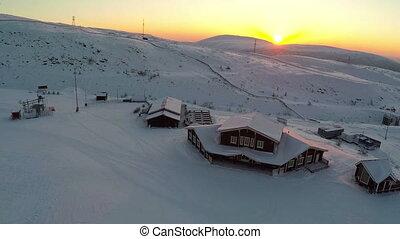 Aerial view of ski resort at sunset