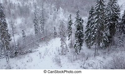 Aerial view of ski resort - ski lift and snow-covered...