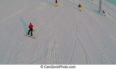 Aerial view of skiers and snowboarders