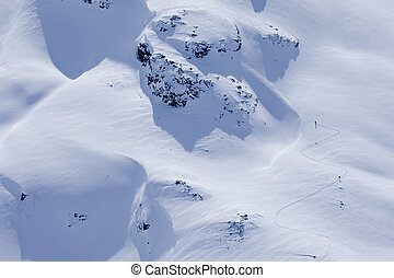 Aerial View of Skiers On a Mountaintop