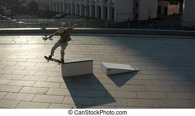Aerial view of skillful skater sliding on curb - Drone shot...