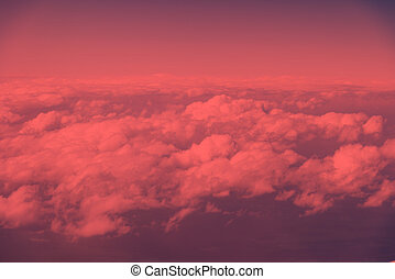 Aerial view of sky with fluffy clouds. Retro toned abstract background.