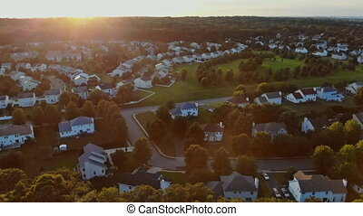 Aerial view of sleeping area houses waterfront at sunset....