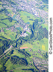 Aerial view of small town near forest