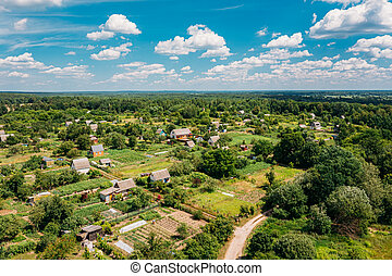 Aerial View Of Small Town, Village Cityscape Skyline In Summer Day. Residential District, Houses And Vegetable Garden Beds In Bird's-eye View