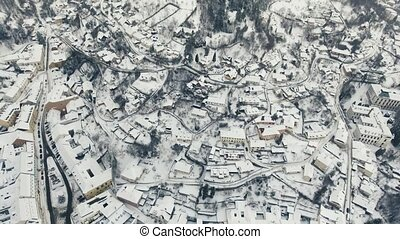 Aerial view of small town with hills in winter. - Aerial...