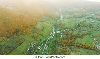Aerial view of small town with hills, Slovakia. Autumn...