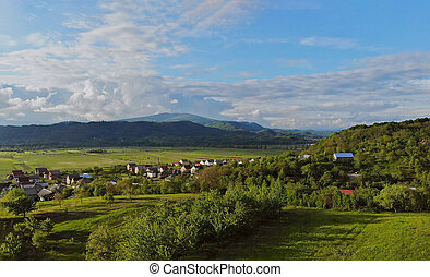 Aerial view of small village surrounded by mountains Karpaty Ukraine