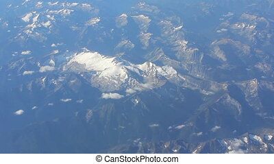 Aerial View Of Snow Capped Mountain - An aerial view of a...