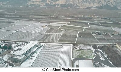 Aerial view of snow covered fields and farms, northern Italy