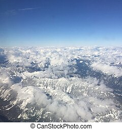Aerial view of snow covered mountains