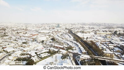 Aerial view of snow covered town 4k - Aerial view of snow ...