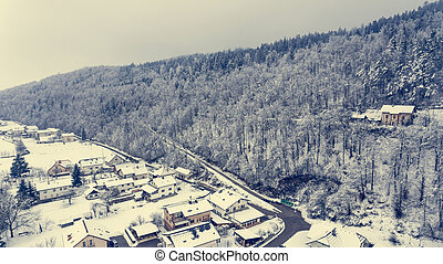 Aerial view of snow covered town.