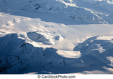 Snow covered moutain peaks perfect for heli-skiing in British Columbia, Canada.