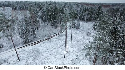 aerial view of snowy forest at winter time