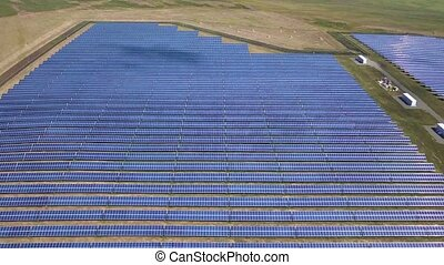 Aerial view of Solar Panels Farm (solar cell) with sunlight....