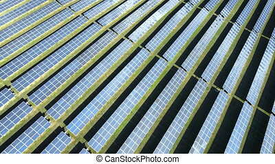 Aerial view of solar panels on a sunny day. power farm producing clean energy. High quality 4k footage