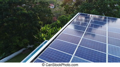 Aerial view of solar panels on the roof of villa