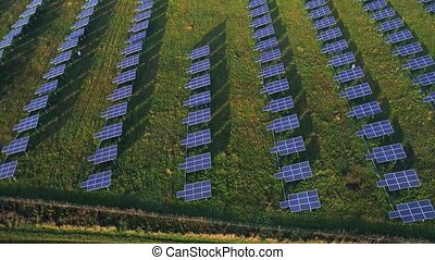 aerial view of solar plant in green fields