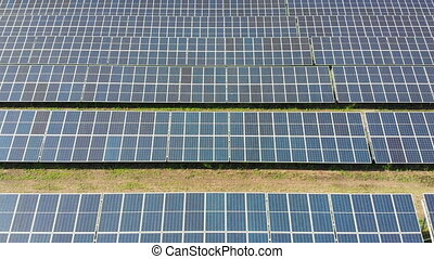 Aerial view of Solar Power Station. Panels Stand in a Row on...
