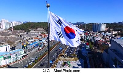 Aerial View of South Korean flag waving in wind , Busan , South Korea, Asia