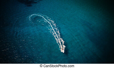 Aerial view of speed boat in motion. Water transportation ...
