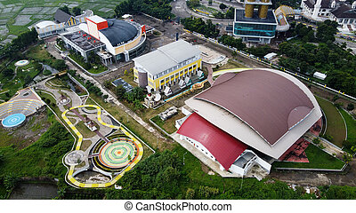 Aerial view of sport arena and mosque in Bandung, Indonesia and noise cloud. Bandung, Indonesia - 04 22 2021