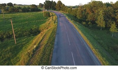 aerial view of sport car driving in fields
