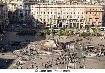 Aerial view of square from roof of famous Cathedral Duomo di Milano on piazza in Milan.
