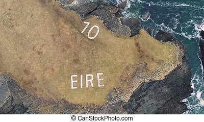 Aerial view of St. John's Point and the Eire 10 marking next to the lighthouse, County Donegal, Ireland.