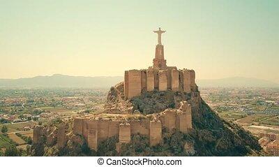 Aerial view of statue of Christ and Castillo de Monteagudo,...