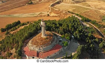 Aerial view of Statue Of The Christ Of The Otero In Palencia, Spain. High quality 4k footage