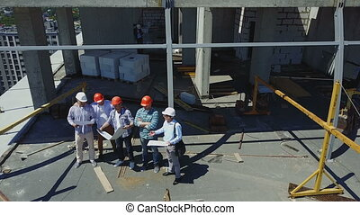 Aerial View Of Successful Team Of Builders, Engineers And...