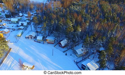 Aerial view of summer residence village at winter time under...