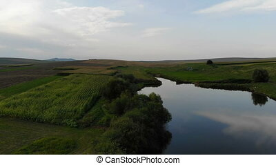 Aerial view of summer rural landscape: lake, green fields...